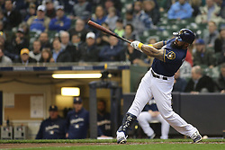 April 18, 2018 - Milwaukee, WI, U.S. - MILWAUKEE, WI - APRIL 18: Milwaukee Brewers first baseman Eric Thames (7) hits a third inning home run during a baseball game between the Milwaukee Brewers and the Cincinnati Reds at Miller Park on April 18, 2018 in Milwaukee, WI. (Photo by Larry Radloff/Icon Sportswire) (Credit Image: © Larry Radloff/Icon SMI via ZUMA Press)