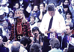 """Governor Bill Clinton (Democrat of Arkansas), right, and his wife, Hillary Rodham Clinton, left, at a campaign rally at Fairgrounds Junior High School in Nashua, NH, USA, on February 16, 1992. The Clintons were campaigning in advance of New Hampshire's """"First in the Nation"""" presidential primary. Photo by Ron Sachs/CNP/ABACAPRESS.COM"""