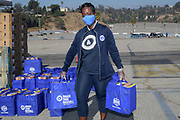 Los Angeles Dodgers Foundation chief executive officer Nichol Whiteman distributes meals during LADF 16th annual Thanksgiving Turkey Giveaway at Dodger Stadium, Thursday, Nov. 19, 2020, in Los Angeles.