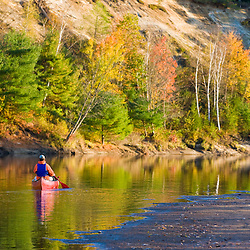 A man canoeing on the Merrimack River in Canterbury, New Hampshire.