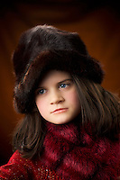 My daughter Erin  8 years old in a fur hat and red scarf..