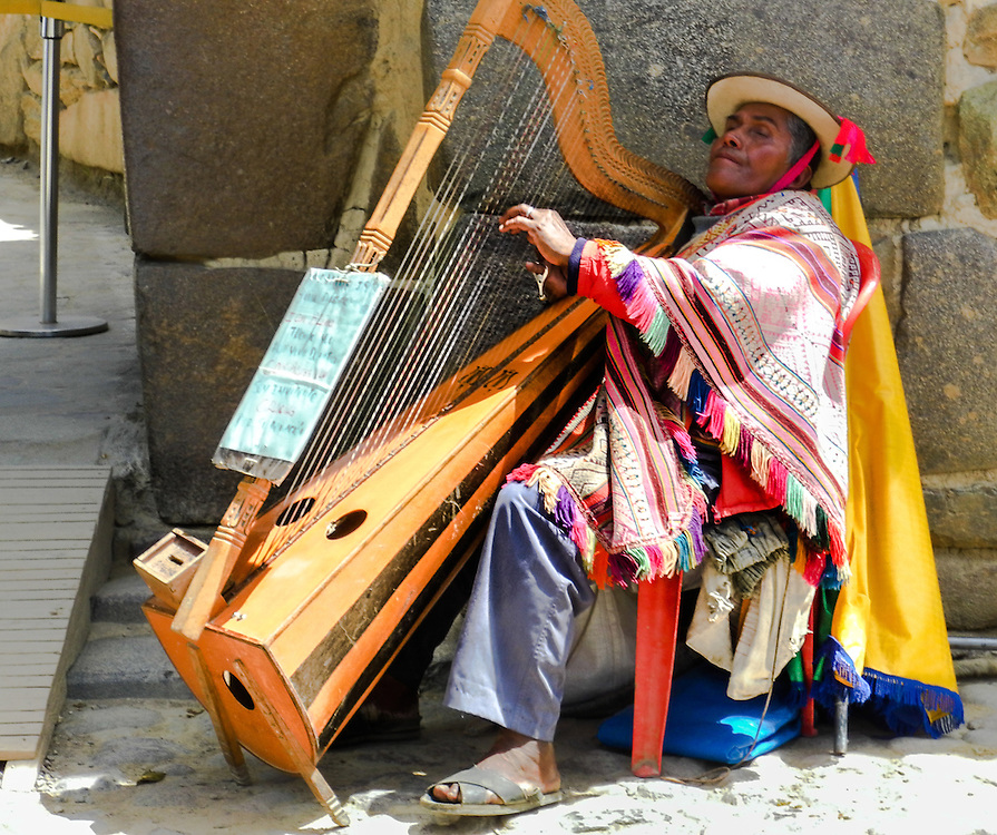 Blind musician playing his harp at the entrance of Ollantaytambo ruins. Simply amazing.
