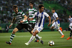 April 18, 2018 - Lisbon, Portugal - Porto's Spanish midfielder Oliver Torres (R ) vies with Sporting's defender Sebastian Coates from Uruguay during the Portugal Cup semifinal second leg football match Sporting CP vs FC Porto at the Alvalade stadium in Lisbon on April 18, 2018. (Credit Image: © Pedro Fiuza/NurPhoto via ZUMA Press)