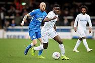 Coventry City forward Bright Enobakhare (24) gets away from Peterborough Utd forward Marcus Maddison (21) during the EFL Sky Bet League 1 match between Peterborough United and Coventry City at London Road, Peterborough, England on 16 March 2019.