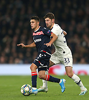 Crvena Zvezda's Mateo Garcia and Tottenham Hotspur's Ben Davies<br /> <br /> Photographer Rob Newell/CameraSport<br /> <br /> UEFA Champions League Group B - Tottenham Hotspur v Crvena Zvezda - Tuesday 22nd October 2019  - Tottenham Hotspur Stadium - London<br />  <br /> World Copyright © 2018 CameraSport. All rights reserved. 43 Linden Ave. Countesthorpe. Leicester. England. LE8 5PG - Tel: +44 (0) 116 277 4147 - admin@camerasport.com - www.camerasport.com