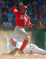 The Angels' Erick Aybar celebrates after tagging out the Rangers' Elvis Andrus trying to steal for the last out of the Halos' 11-10 victory over Texas Saturday at Globe Life Park in Arlington, Texas.