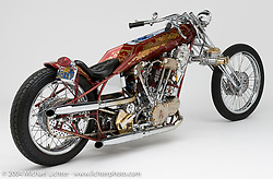 """Custom 100 cubic inch Harley-Davidson Knucklehead known as Untouchable by Arlen Ness that was built between 1964 and 1977 when it took the form you see here.  This was Arlen's first Harley-Davidson that he purchased for $300, although very little of the original bike is left. With its large motor, Magnuson Supercharger, it's array of belts and pulleys, the twin Weber carburetors, and the 5/8 Jim Davis chrome moly frame, it set a new bar for innovation in custom bikes, not only for other builders but for Arlen himself. The bike is still owned by Arlen Ness although it has been on exhibit at the Motorcycle Hall of Fame Museum in Pickerington, OH as part of the """"Awesome-Ness"""" exhibition in the """"Hall of Legends"""" 2009- 2010. It was included in the Rebel Rousers - Motorcycle Icons that Inspire Us to Ride exhibit at the Buffalo Chip's Lichter Exhibition Hall.  Photographed by Michael Lichter on October 14, 2004, in Dublin, CA. ©2004 Michael Lichter"""