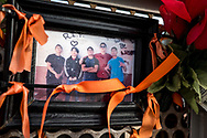 A photograph of Javier Amir Rodriguez, 15, second from left, the youngest of the 23 victims that died in the Aug. 3 shooting, is posted on a wall along a memorial at Ponder Park in El Paso, Texas, Sunday, August 2, 2020.