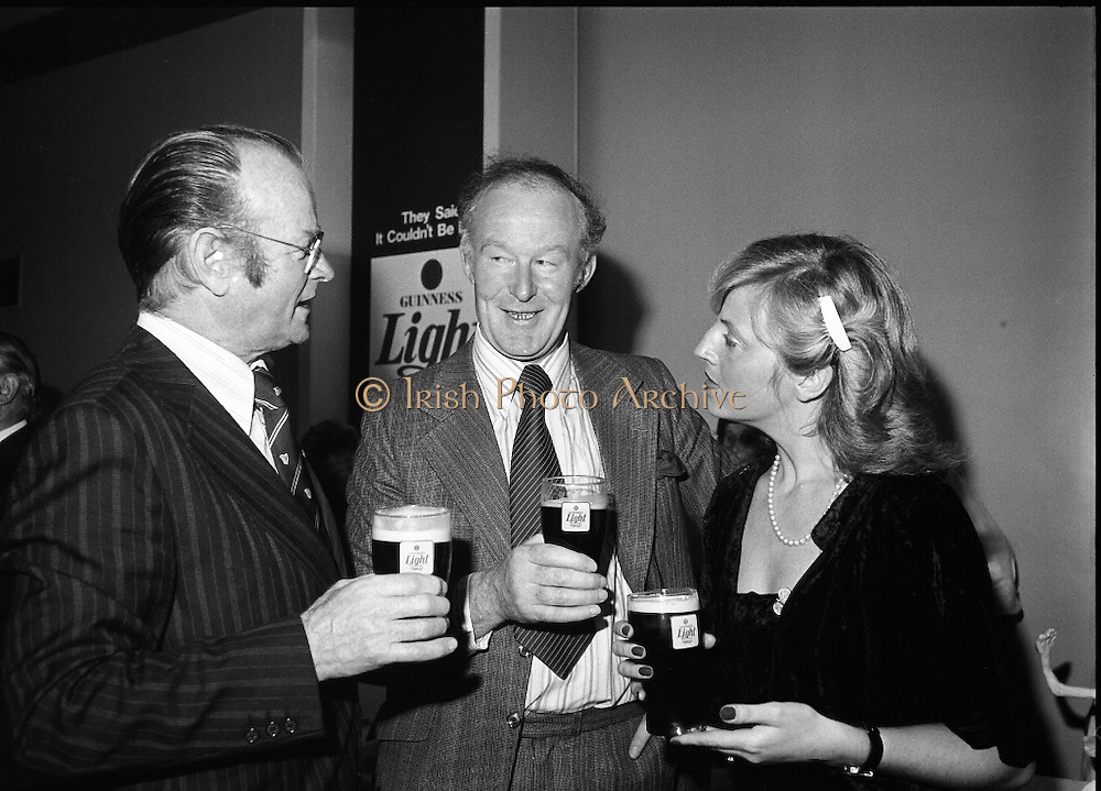 """Guinness Launch """"Guinness Light"""".  (M79)..1979..26.06.1979..06.26.1979..26th June 1979..At the Guinness Theatre in St James Gate Brewery,Guinness launched """"Guinness Light"""". With a spectacular show Guinness brought to the market a new lighter version of its world famous stout. it is hoped that it will fill a niche with younger drinkers frequenting Ireland's pubs and clubs..Jim Stewart, Home Sales Manager,G G S, Ted McGovern, Outgoing Chairman,Dublin Licensed Vitners Assoc and mrs Anne O'Doherty were pictured at the launch of Guinness Light."""