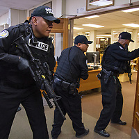 (Left to right) Gallup Police officers Darris Johnson, Patrick Largo and Dewayne Holder enter the library looking for the active shooter during a drill Thursday morning at the Octavia Fellin Public Library.