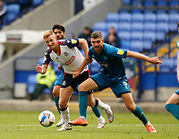 Football - 2020 / 2021 Sky Beat League Two - Bolton Wanderers vs Grimsby Town<br /> <br /> Eoin Doyle of Bolton Wanderers and Luke Waterfall of Grimsby Town challenge for possession on the edge of the Grimsby Town area, at University of Bolton Stadium.<br /> <br /> COLORSPORT/ALAN MARTIN