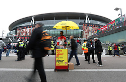 A programme seller before the Premier League match at the Emirates Stadium, London.