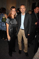 LUKE & LISA JOHNSON at a party to celebrate the publication of 101 World Heroes by Simon Sebag-Montefiore at The Savile Club, 69 Brook Street, London W1 on 9th October 2007.<br /><br />NON EXCLUSIVE - WORLD RIGHTS