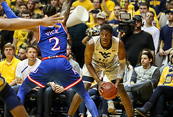 Jan 15, 2018; Morgantown, WV, USA; West Virginia Mountaineers forward Lamont West (15) pauses with the ball during the second half against the Kansas Jayhawks at WVU Coliseum. Mandatory Credit: Ben Queen-USA TODAY Sports