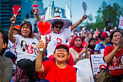 01 MARCH 2013 - BANGKOK, THAILAND: .Pheu Thai supporters cheer for Pongsapat Pongchareon, the Pheu Thai Gubernatorial candidate for Bangkok during the last campaign rally of the race. The election is Sunday, March 3 and no campaigning is allowed 24 hours before election day. Police General Pongsapat Pongcharoen (retired), a former deputy national police chief who also served as secretary-general of the Narcotics Control Board is the Pheu Thai Party candidate in the upcoming Bangkok governor's election. He resigned from the police force to run for Governor. Former Prime Minister Thaksin Shinawatra reportedly personally recruited Pongsapat. Most of Thailand's reputable polls have reported that Pongsapat is leading in the race and likely to defeat Sukhumbhand Paribatra, the Thai Democrats' candidate and incumbent. The loss of Bangkok would be a serious blow to the Democrats, whose national base has been the Bangkok area.     PHOTO BY JACK KURTZ