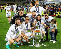 Players of Real celebrate with the Trophy after winning during football match between Real Madrid (ESP) and Atlético de Madrid (ESP) in Final of UEFA Champions League 2016, on May 28, 2016 in San Siro Stadium, Milan, Italy. Photo by Vid Ponikvar / Sportida