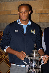 © licensed to London News Pictures. Manchester, UK  23/05/2011. Vincent Kompany. Tens of thousands of fans line the streets of Manchester as Manchester City Football Club hold an open-topped bus parade through the city. The team are celebrating winning the FA Cup, their first trophy in 35 years, and for qualifying for next season's Champions League. Please see special instructions for usage rates. Photo credit should read Joel Goodman/LNP
