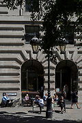 Lunchtime office workers enjoy hot sunshine outside a restaurant in Royal Exchange Buildings during the 2018 heatwave in the City of London, the capital's historic financial district, on 2nd August 2018, in London, England.
