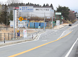 """The sign of Fukushima Daiichi nuclear power plant is seen in the district of Okuma, Fukushima Prefecture, Japan, March 7, 2015. The scenes from the towns and villages still abandoned four years after an earthquake triggered tsunami breached the defenses of the Fukushima Daiichi nuclear power plant, would make for the perfect backdrop for a post- apocalyptic Hollywood zombie movie, but the trouble would be that the levels of radiation in the area would be too dangerous for the cast and crew. The central government's maxim of """"Everything is under control"""" in and around the nuclear plant, has been a blatant lie since the disaster began to unfold on March 11, 2011, quickly escalating into the worst civilian nuclear crisis ever to happen, with twice the amount of radioactive materials being released into the environment than the Chernobyl disaster in 1986. EXPA Pictures © 2015, PhotoCredit: EXPA/ Photoshot/ Liu Tian<br /> <br /> *****ATTENTION - for AUT, SLO, CRO, SRB, BIH, MAZ only*****"""