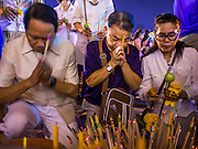 "04 MARCH 2015 - BANGKOK, THAILAND: People pray in front of the ""wiharn,"" or prayer hall, at Wat Benchamabophit on Makha Bucha Day. Makha Bucha Day is an important Buddhist holy day and public holiday in Thailand, Cambodia, Laos, and Myanmar. Many people go to temples to perform merit-making activities on Makha Bucha Day. Wat Benchamabophit is one of the most popular Buddhist temples in Bangkok.       PHOTO BY JACK KURTZ"