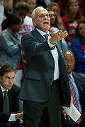 DALLAS, TX - JANUARY 4: SMU Mustangs head coach Larry Brown has words with an official against the Connecticut Huskies on January 4, 2014 at Moody Coliseum in Dallas, Texas.  (Photo by Cooper Neill) *** Local Caption *** Larry Brown
