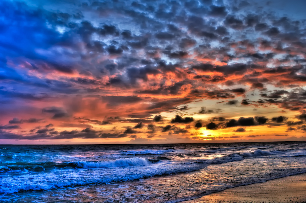 Sunset photographed in Bonita Springs, Florida in June 2009. It was one of those strange evening skies that was incredibly colorful and busy. Glad I was out working that night!