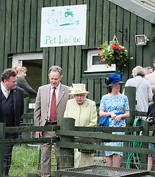 The Queen visited Gorgie City Farm in Edinburgh today as part of Royal Week.<br /> <br /> Gorgie City Farm is a community based initiative first opened in 1982<br /> <br /> Pictured: The Queen is shown around the inner city farm<br /> <br /> Alex Todd | Edinburgh Elite media