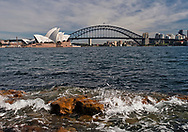 A view of the Sydney Opera House and the Sydney Bridge.