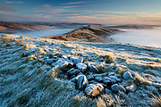Dawn light and a heavy January frost transform this classic scene of the Great Ridge from Mam Tor. Edale and the Hope Valley are filled by a temperature inversion. Winter, Derbyshire, Peak District, England, UK.