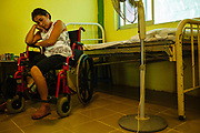 Liseth Elvira Lopez Hernandez, 22, after two months of recovery, rests into a room of the Albergue Buen Pastor. Her husband was killed in a car accident years ago in Guatemala, after that, Elvira attempted to reach the U.S. but fell down from the train on movement and lost her right leg, in Tapachula, Mexico, April 20, 2013.