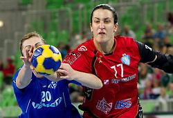 Miranda Tatari of Podravka vs Andrea Lekic of Krim  during handball match between RK Krim Mercator (SLO) and RK Podravka Vegeta (CRO) in Women's EHF Champions League, on November 13, 2010 in Arena Stozice, Ljubljana, Slovenia. (Photo By Vid Ponikvar / Sportida.com)