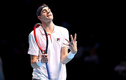 John Isner appears frustrated during the men's singles match during day six of the Nitto ATP Finals at The O2 Arena, London.