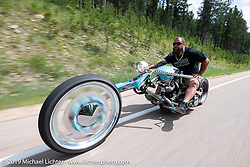 A unique single-sided front end on this Harley-Davidson custom on the Cycle Source ride down Vanocker Canyon back from Nemo to the Iron Horst Saloon during the Sturgis Black Hills Motorcycle Rally. SD, USA. Wednesday, August 7, 2019. Photography ©2019 Michael Lichter.
