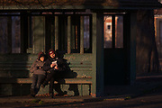 A couple read a shared book in a public park shelter, on 5th January 2017, in Ruskin Park, London borough of Lambeth, England.