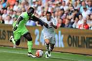 Jefferson Montero of Swansea city is challenged by Bacary Sagna of Manchester city. Barclays Premier league match, Swansea city v Manchester city at the Liberty Stadium in Swansea, South Wales on Sunday 15th May 2016.<br /> pic by Andrew Orchard, Andrew Orchard sports photography.