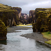 It was cold with spitting rain and mostly dull, grey skies.  But still, what a ruggedly beautiful place Fjaðrárgljúfur is! The cliffs were soggy, slippery. Yet you can see one brave soul out walking in the upper right of the photo.