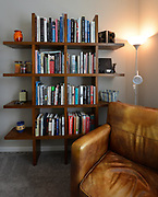 A tic-tac-toe bookshelf next to a comfortable chair in the reading room where the Glen's watch the news and read their morning newspaper. Sheridan and Rikki Glen are At Home in their Tanglewood subdivision home in Caseyville, IL on Wednesday January 16, 2019. <br /> Photo by Tim Vizer