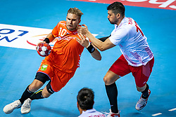 The Dutch handball player Patrick Miedema and Ugur Erceylan in action during the European Championship qualifying match against Turkey in the Topsport Center Almere.