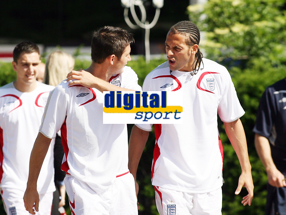 Photo: Chris Ratcliffe.<br />England training session. 07/06/2006.<br />Frank Lampard chats with Rio Ferdinand as they get off the bus for training.