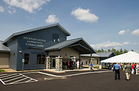 Belknap County Community Corrections facility welcomes visitors to tour the building following the ribbon cutting ceremony on Thursday afternoon.  (Karen Bobotas/for the Laconia Daily Sun)