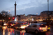 Traffic in Trafalgar Square at dusk. This part fo central London is very busy as a junction between many major roads.