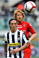Mauro German Camoranesi (Juventus) e Davide Bionidini (Cagliari)<br /> Torino 11/04/2010 Stadio Olimpico<br /> Juventus Cagliari - Campionato di Serie A Tim 2009-10.<br /> Foto Giorgio Perottino / Insidefoto