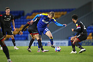 AFC Wimbledon midfielder Jack Rudoni (12) battles for possession during the EFL Sky Bet League 1 match between AFC Wimbledon and Lincoln City at Plough Lane, London, United Kingdom on 2 January 2021.