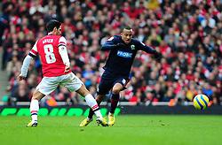Blackburn Rovers' Martin Olsson skips past a challenge from Arsenal's Mikel Arteta - Photo mandatory by-line: Dougie Allward/JMP - Tel: Mobile: 07966 386802 16/02/2013 - SPORT - FOOTBALL - Emirates Stadium - London -  Arsenal V Blackburn Rovers - FA Cup - Fifth Round