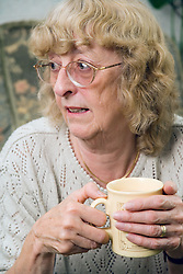 Woman with a mug of coffee,