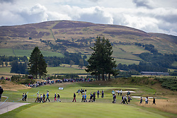 Players make their way down the first, lined by fans during the Team Competition Mixed - Foursomes Stroke Play on day ten of the 2018 European Championships at Gleneagles PGA Centenary Course.