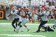 AUSTIN, TX - SEPTEMBER 26:  Tyrone Swoopes #18 of the Texas Longhorns scrambles against the Oklahoma State Cowboys during the 2nd quarter on September 26, 2015 at Darrell K Royal-Texas Memorial Stadium in Austin, Texas.  (Photo by Cooper Neill/Getty Images) *** Local Caption *** Tyrone Swoopes