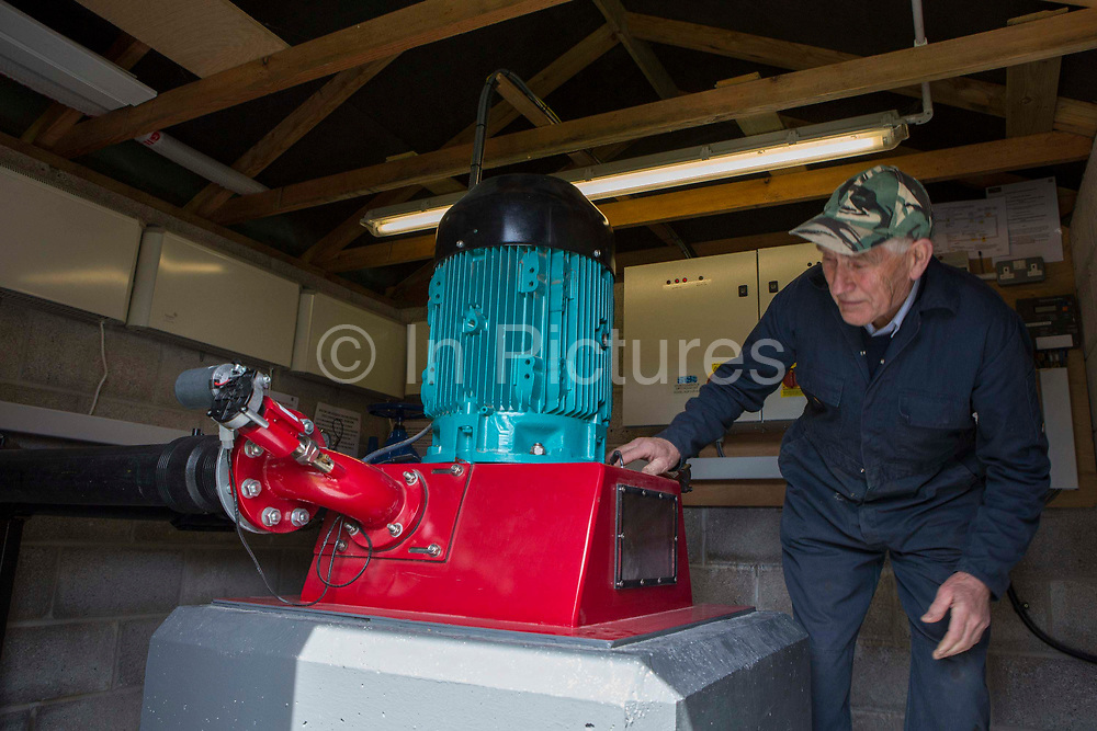 Farmer Howell Williams checking in on his 15kW micro hydro power generator producing electricity at Abercrave Farm on the Brecon Beacons, Wales.