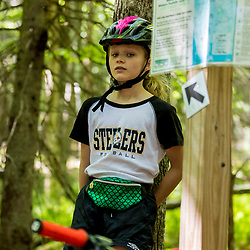 A girl rides her mountain bike at the Shepards Farms Preserve in Norway, Maine.