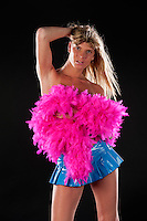 Transexual male posing in studio with costume.